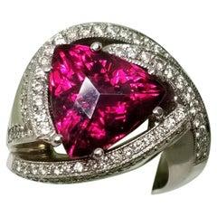"14 Karat ""Rubelite"" Tourmaline and Swirling Contemporary Diamond Ring"
