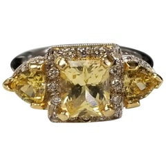 14 Karat White Gold Radiant Cut Yellow Sapphire Halo and Diamond Ring