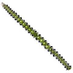 Peridot 18 Karat White Gold Diamonds and Sapphires Cuff Bracelet