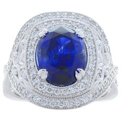 5.51 Carat Oval Blue Sapphire and Diamond Cocktail Ring in 18 Karat White Gold