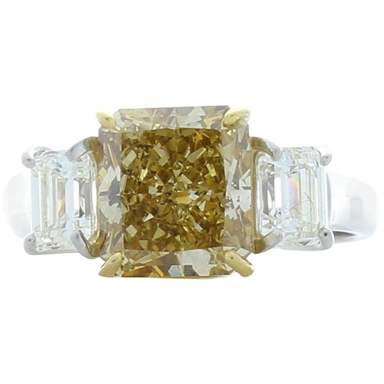 3.00 Carat Radiant Cut Fancy Yellow Diamond Cocktail Ring in Platinum For Sale