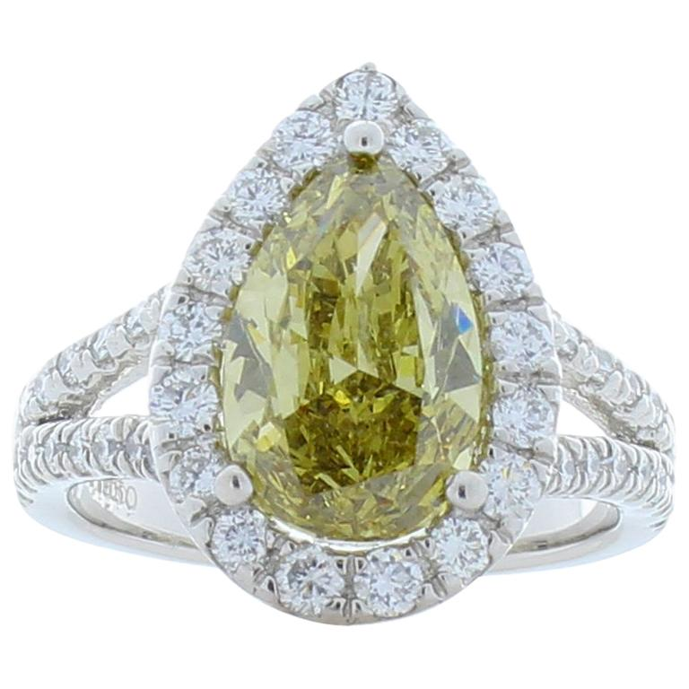 GIA Certified 3.01 Carat Pear Shape Fancy Yellow Diamond Cocktail Ring In Plat For Sale