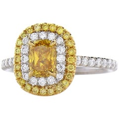 GIA Certified 0.70 Carat Cushion Cut Fancy Vivid Yellow Diamond Cocktail Ring