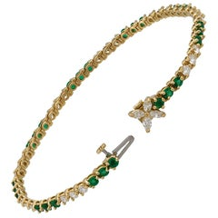 Tiffany & Co. 18 Karat Yellow Gold Diamond and Emerald Tennis Bracelet