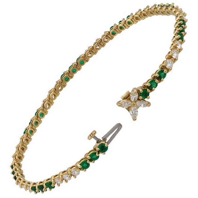 Tiffany & Co. 18 Karat Yellow Gold Diamond and Emerald Tennis Bracelet For Sale