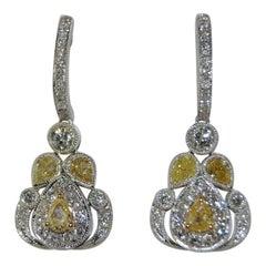 1.31 Carat Yellow and White Diamond Earrings in 18 Karat Gold