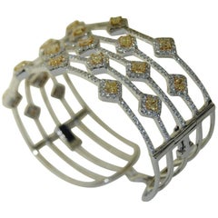 8.69 Carat Yellow and White Diamond Bangle Bracelet, 18 Karat Gold