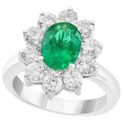 3 Carat Oval Cut Colombian Emerald and Diamond 18 Karat Gold Ring Estate