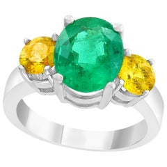 3 Carat Oval Cut Colombian Emerald and Yellow Sapphire 18 Karat Gold Ring