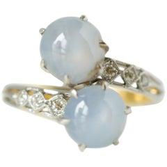 1890s Star Sapphire and Diamond 'Toi et Moi' Bypass 14 Karat White Gold Ring