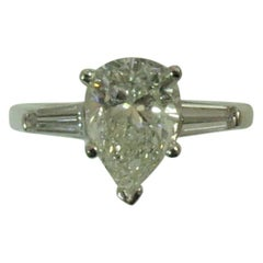 Platinum Ring  Prong Set With Pear Shape Diamond Weighing 2.02cts and Baguettes