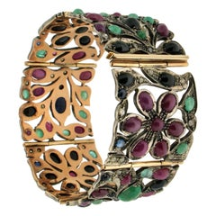 Ruby 14 Karat Gold and Silver Emeralds Sapphires Diamonds Cuff Bracelet
