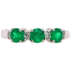 0.91 Carat Emerald and Diamond Ring