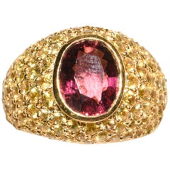 18 Karat Gold Dome Ring with Oval Pink Tourmaline and Pave Yellow Sapphires