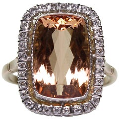 Antique Platinum and 18 Karat Two-Tone Topaz and Diamond Halo Ring