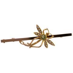 Peridot Seed Pearl Dragonfly Bar Brooch 9 Karat Yellow Gold, circa 1925