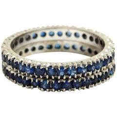 Two 14 Karat White Gold Blue Sapphire Eternity Wedding Band Stack