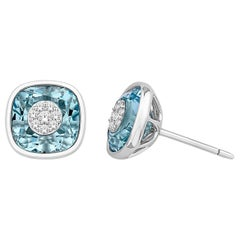 Diamonds Inlaid Into Cushion Shape Blue Topaz Studs