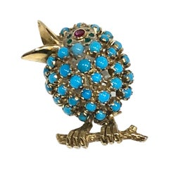18 Karat Bird Brooch Set with Turquoise, Ruby and Emeralds