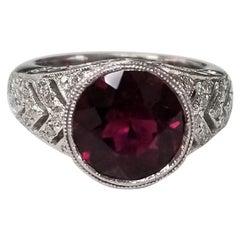 Round Garnet and Diamond Ring