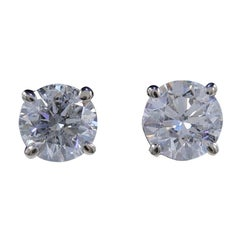 Round Diamond Solitaire Stud Earrings 2.00 Carat Set in 14 Karat White Gold