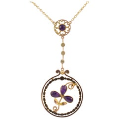 1.00 Carat Amethyst Shamrock Pendant in 9 Karat Gold with Split Chain circa 1920