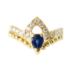 0.75 Carat Diamond and Sapphire 18 Karat Yellow Gold Ring