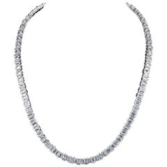 Emerald Cut Diamonds Are Set in White Gold Necklace