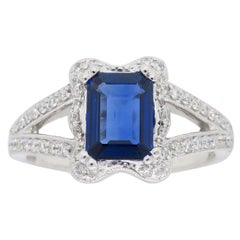 Emerald Cut Blue Sapphire and Diamond Halo Ring