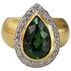 18 Karat Green Tourmaline with Diamond Pave' Halo