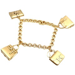 Hermes 4 Hanging Bag Charm Yellow Gold Link Bracelet