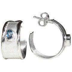 Yianni Creations 1.14 Carat Oval Blue Topaz Fine Silver Palladium Hoop Earrings