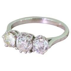 1.48 Carat Cushion and Round Old Cut Diamond Platinum Trilogy Ring