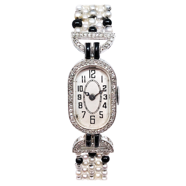 Art Deco Platinum Diamond Pearl and Onyx Ladies Mechanical Wristwatch