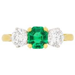 Garrard Emerald and Diamond Three-Stone Engagement Ring, circa 1980s