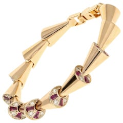 Retro Rose Gold Diamond and Ruby Peek-a-Boo Bracelet, circa 1950s