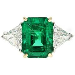 Platinum Natural Zambian Emerald Ring with Trillion Cut Diamonds
