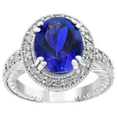 6 Carat Oval Tanzanite and 1 Carat Diamond Ring 14 Karat White Gold, Estate