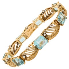 1950s Flexible Emerald Cut Aquamarine with Diamonds Gold Ropework Bracelet