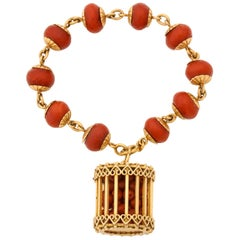 1950s Faceted Oxblood Coral with Coral Beads in a Cage Charm Gold Link Bracelet