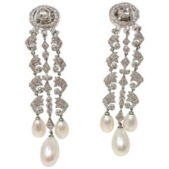 White Round Brilliant Diamond And White South Sea Pearl Earrings In 18k Gold.