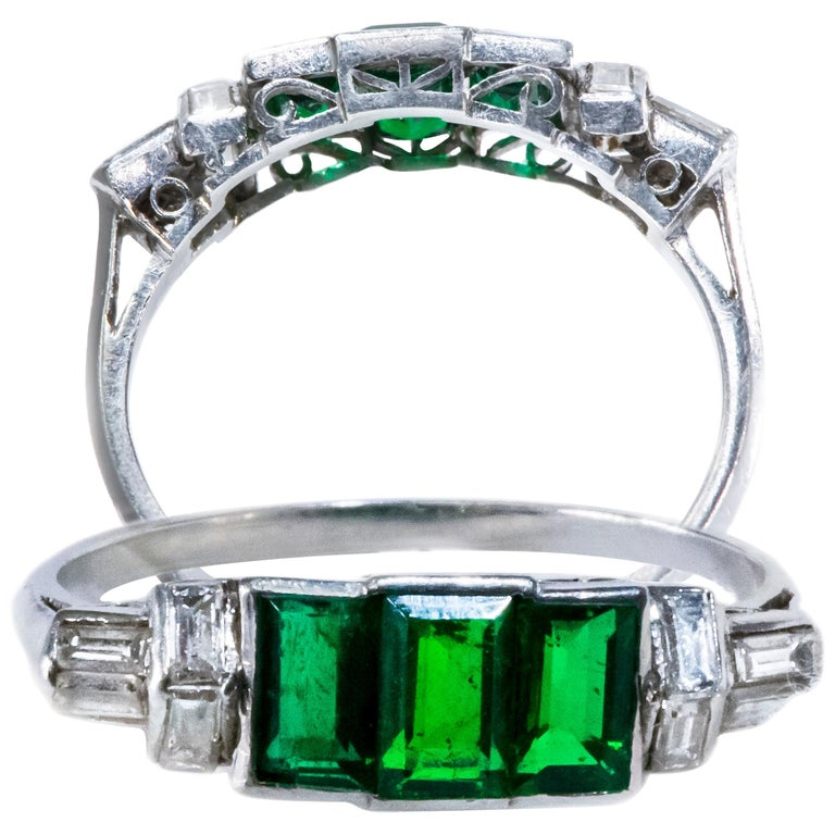 Elegant Art Deco 1920s Platinum 2 Cts Emerald Cut Emerald & Diamond Trilogy Ring For Sale