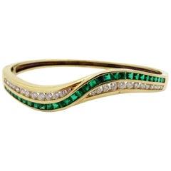 Estate 14 Karat Yellow Gold Emerald and Diamond Swirl Bangle Bracelet