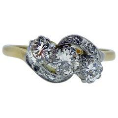 Art Deco Diamond Three-Stone Ring, 0.74 Carat Cross-Over Twist Diamond Shoulders