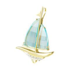 7 Carat Blue Topaz and 14 Karat Yellow Gold Sail Boat Pendant