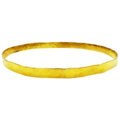 18 Karat Yellow Gold Hammered Skinny Bangle