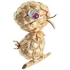 Boucheron Brooch Representing a Chick in 18 Carat Yellow Gold Diamonds and Ruby
