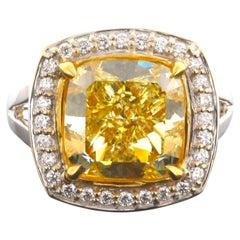 GIA Certified 6.80 Carat Cushion Cut, Natural Fancy Intense Yellow, SI2 Diamond