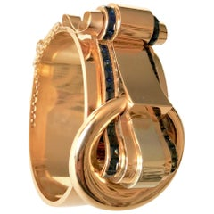 Tank Bracelet circa 1940 Rigid Opening Buckle Pattern Gold 18 Carat Sapphires