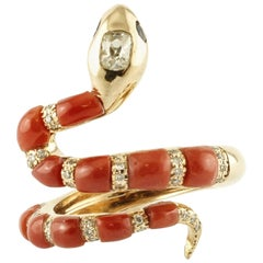 Snake-Shaped Ring in 14 Karat Gold, Rubrum Coral, Diamonds and Blue Sapphires